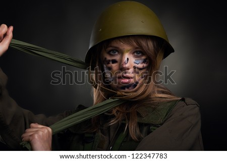 ... army girl, soldier woman in a military uniform over black background