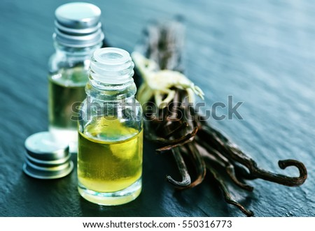 aroma oil in glass bottle, vanilla oil