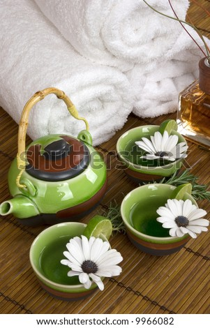 Aromatherapy, relaxing herbal tea and soft cotton towels in a spa