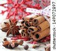 Aromatic spices - cinnamon sticks, star anise, cloves and allspice - typical for Christmas baking and decoration - stock photo
