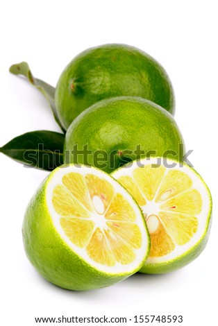 Arrangement of Fresh Ripe Green Lemons Full Body and Halves with Leafs isolated on white background