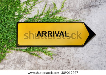 Arrival on yellow sign hanging on ivy wall
