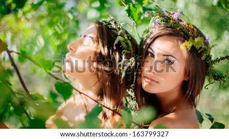 Art portrait of two young girls outdoors. Shallow depth of field