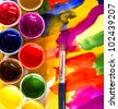 art studio paints, palette, brush - stock photo