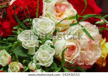 Artificial bouquet of multicolored roses