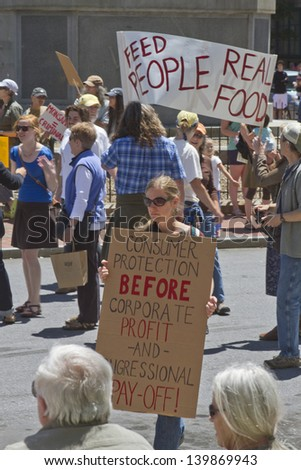 ASHEVILLE - MAY 25: Anti Monsanto and GMO Protesters Display Signs protesting corporate and congressional greed and genetically modified food at an anti GMO rally in Pack Square,  Asheville, NC, USA, on May 25, 2013