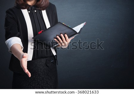 Asia Business woman handshake and blank wall for text and background.Copy Space