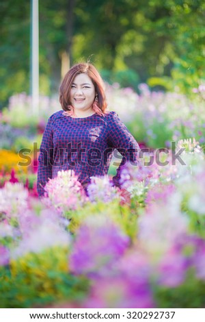 asia fat woman in purple dress with flowers background