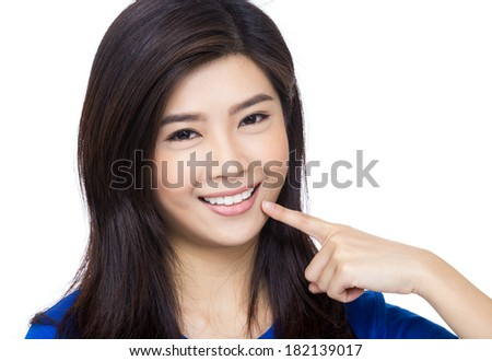 Asia woman pointing to her mouth and teeth