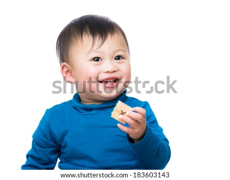 Asian baby boy holding toy block