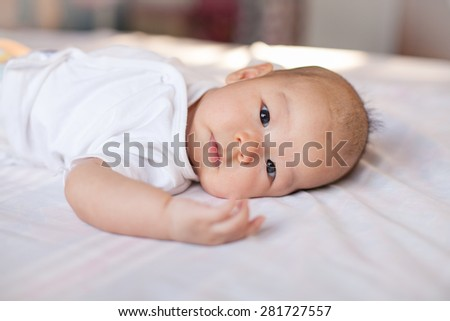 asian baby girl on bed