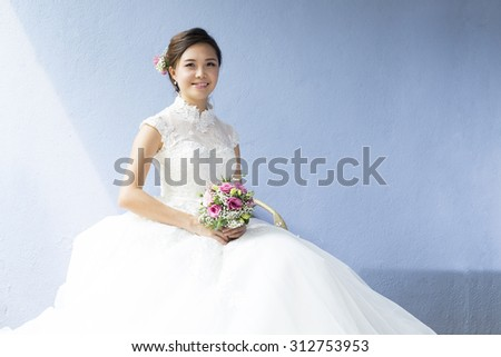 Asian beautiful bride sit on the chair.