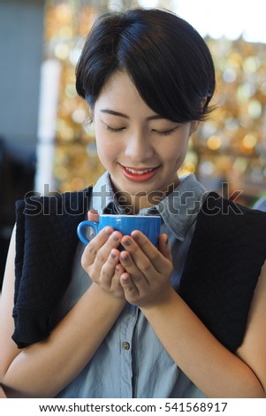 Asian beautiful woman working with Laptop in coffee shop cafe