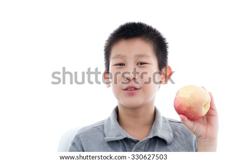 Asian boy eating a red apple isolated on white background