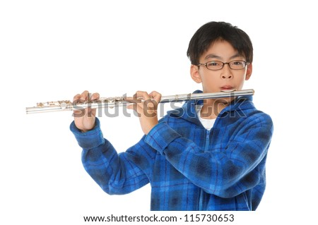 asian boy plays a flute on white background