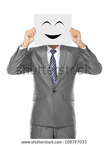Asian business man holding a mask looking at camera isolated on white background