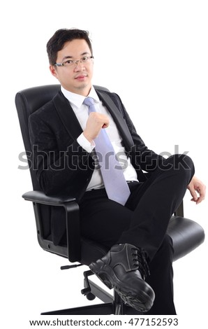 Asian business man seated on chair, isolated on white background.
