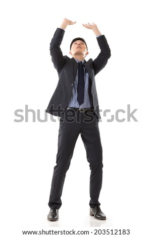 Asian business put hands up against something, full length portrait isolated on white background.