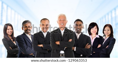 Asian business team in multiracial. Diversity business people form by different races, Indian, Malay, Indonesian, Chinese standing in office environment.
