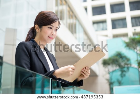 Asian Business woman looking at the document