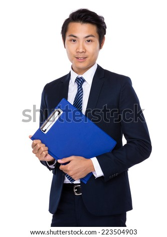 Asian businessman with clipboard