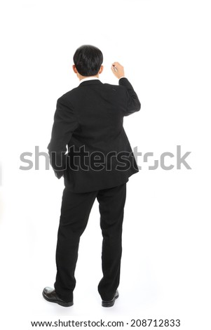 Asian businessman writing something in studio with white background