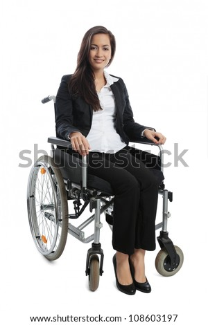 Asian Businesswoman sitting in a wheel chair isolated on white