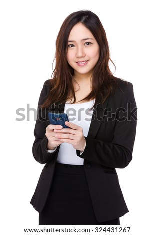 Asian businesswoman use of the mobile phone