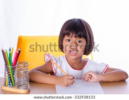 Asian Child Paints Paper on White Background