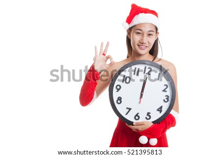 Asian Christmas Santa Claus girl show OK  and clock at midnight  isolated on white background.