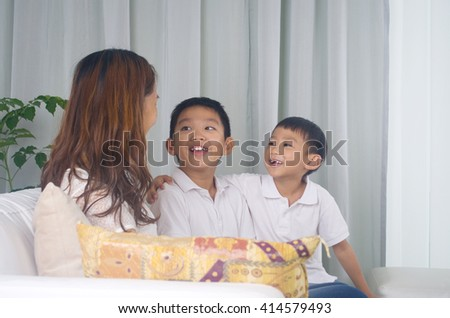 Asian family having fun at home