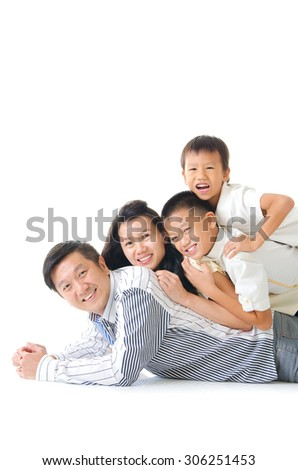 Asian family having piggyback fun