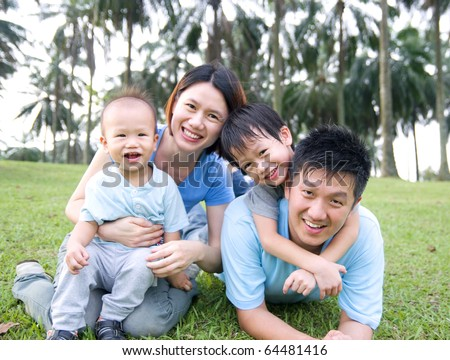 Asian family playing in the park