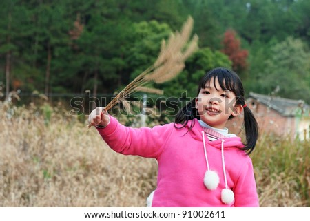 Asian girl playing on the lawn