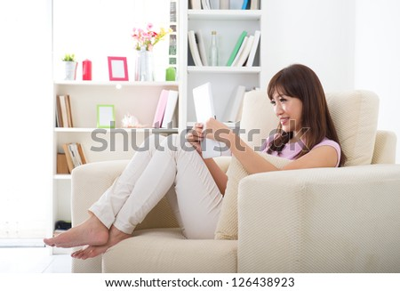 asian girl surfing the internet with tablet pc