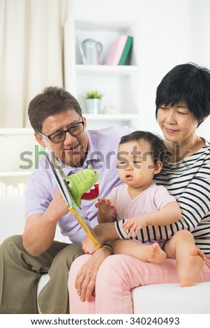 asian grand parents with crying grand daugther