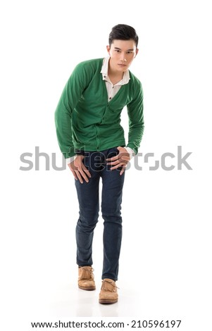 Asian guy with dramatic pose, full length portrait isolated on white background.