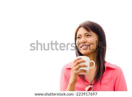 Asian happy woman drinking coffee over white background