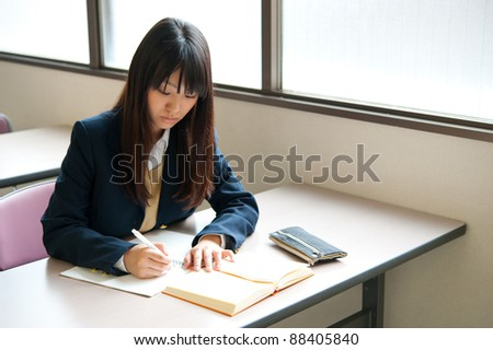 asian high schoolgirl studying