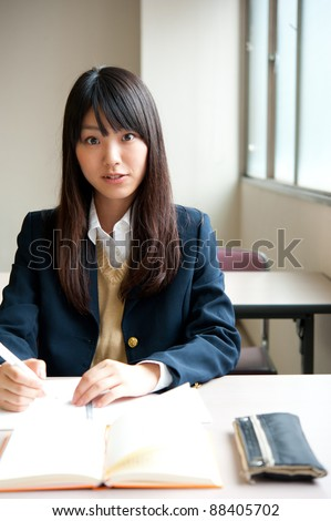 asian high schoolgirl studying in classroom
