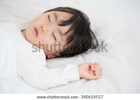 asian kid having nap time.