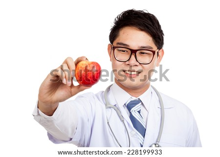Asian male doctor with red apple isolated on white background