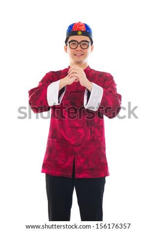 traditional dress cheongsam and gong xi fa cai greetings - stock photo