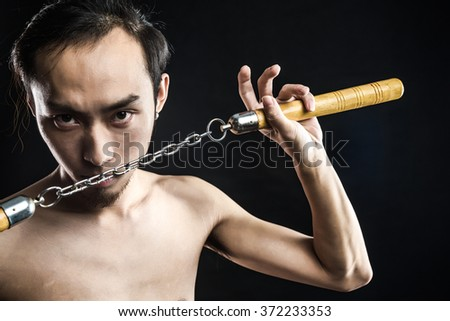 asian man with nunchucks