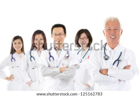 Asian medical team, expertise senior and mature doctors leading young practitioners, standing isolated white background