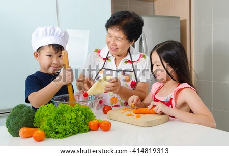 Asian senior woman and grandchildren prepared food in the kitchen