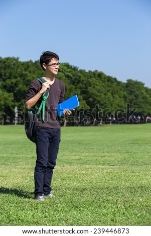 asian student in the park with book and lecture note Bangkok Thailand
