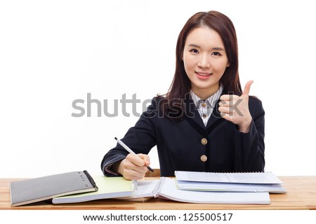 Asian student showing thumb isolated on white background.