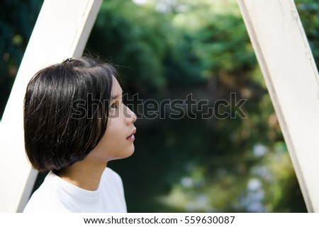 Asian teenage short hair wear white shirt in the park