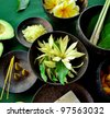 Asian tropical flowers with Balinese spa supplies. - stock photo